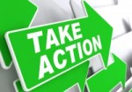 Take Action on Direction Sign - Green Arrow on a Grey Background.